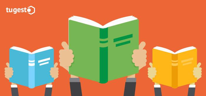 Emprendedores con libros en la manos