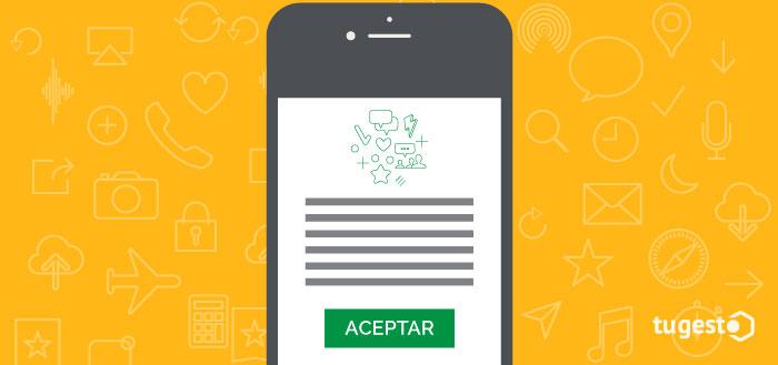 Móvil con el botón para aceptar los términos de privacidad de Whatsapp